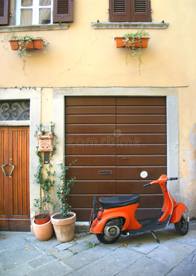 Italian scooter corner. A typically Italian corner with one of the symbol of Italy, the scooter Vespa; you can see this scene all over Italy