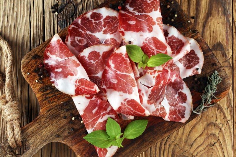Italian sliced cured coppa with spices. Raw ham. Crudo or jamon.  stock photos