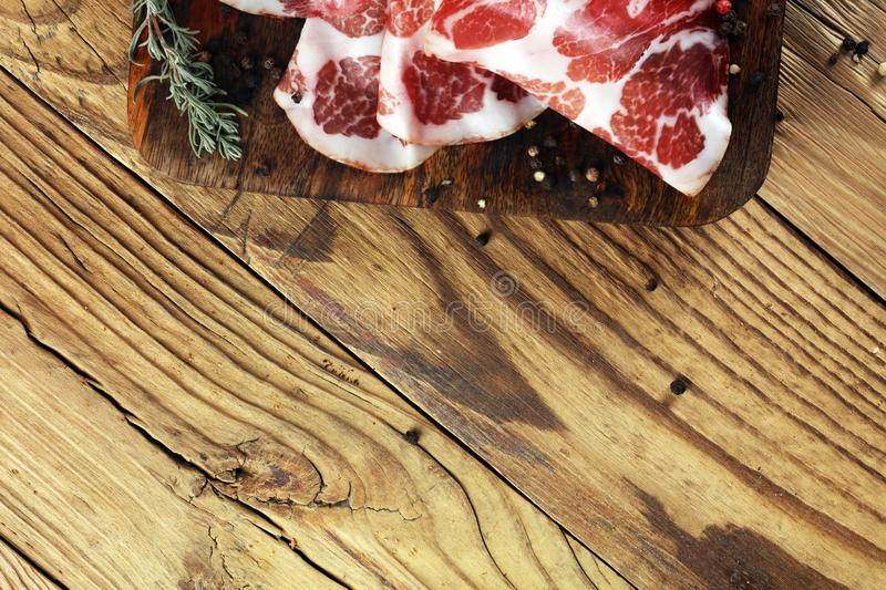 Italian sliced cured coppa with spices. Raw ham. Crudo or jamon.  royalty free stock photography