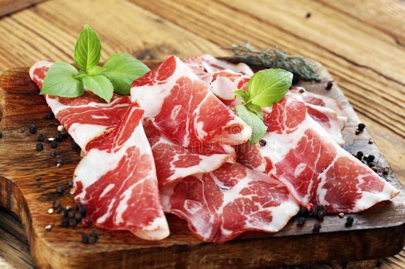 Italian sliced cured coppa with spices. Raw ham. Crudo or jamon.  stock images