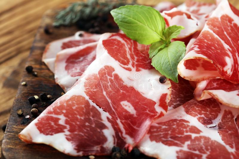Italian sliced cured coppa with spices. Raw ham. Crudo or jamon.  stock photography