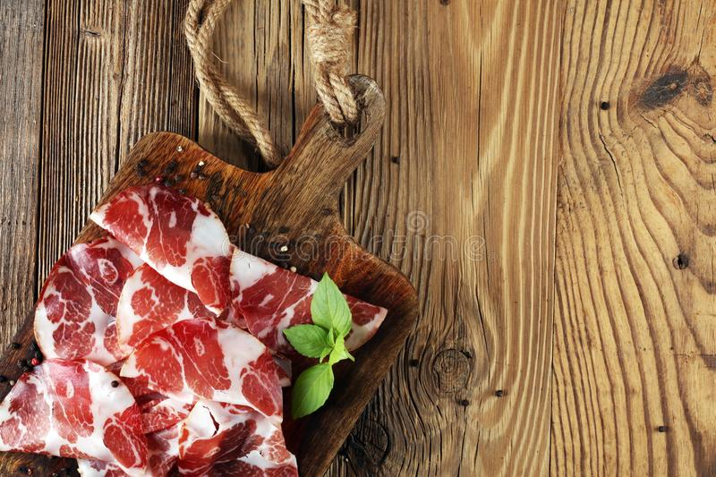 Italian sliced cured coppa with spices. Raw ham. Crudo or jamon.  royalty free stock photo