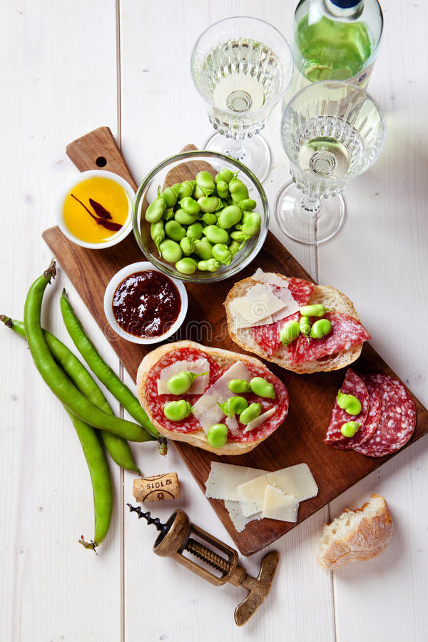 Italian snacks. salami sandwich with parmesan cheese stock photography