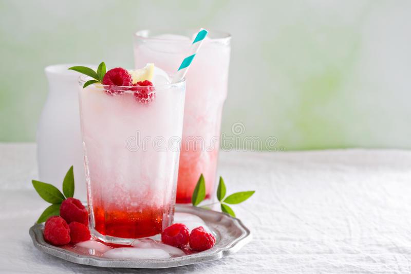 Italian soda drink. With berry syrup and coconut milk royalty free stock image
