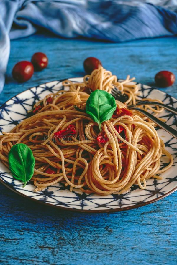 Italian Spaghetti Pasta with Cherry Tomatoes and Basil stock images