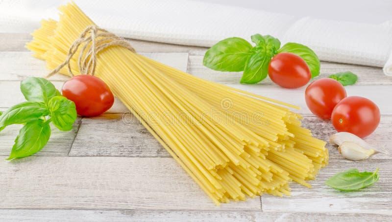 Italian spaghetti pasta and fresh ingredients royalty free stock image