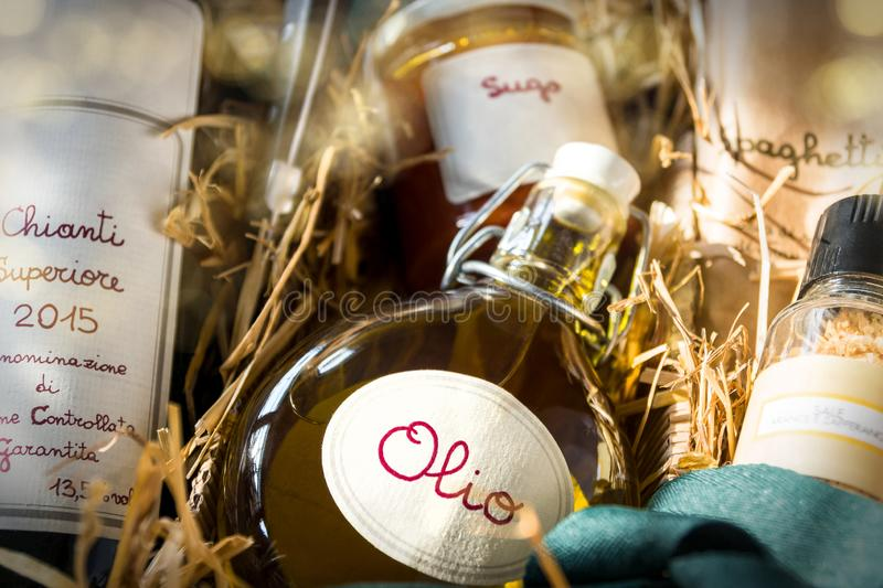 Italian specialty gift pack. Age with red wine, spaghetti, oil, tomato sugo and spice-salt on straw stock photography