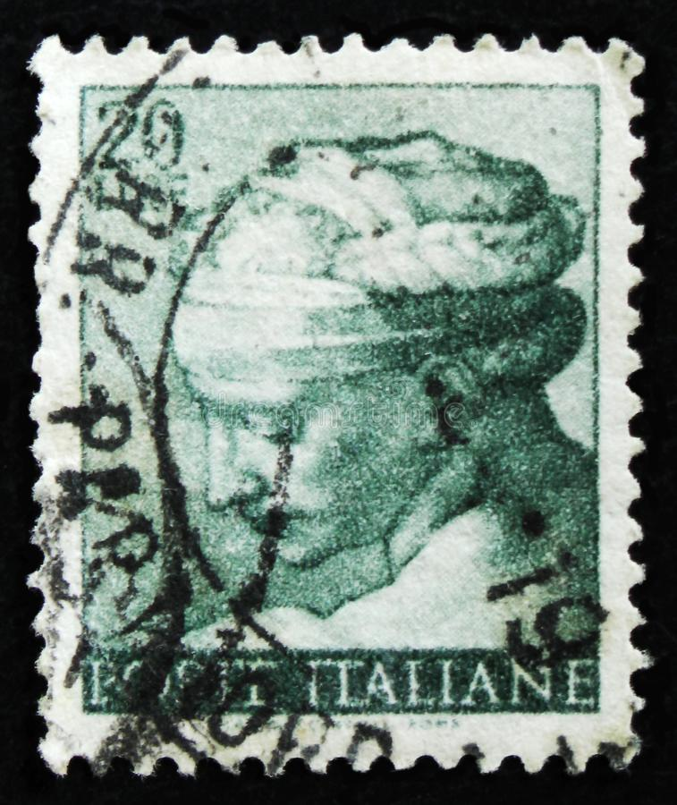 Italian stamp shows head of the Libyan Sibyl by Michelangio, Frescoes of Sistine Chapel, circa 1961. MOSCOW, RUSSIA - APRIL 2, 2017: A post stamp printed in royalty free stock photos