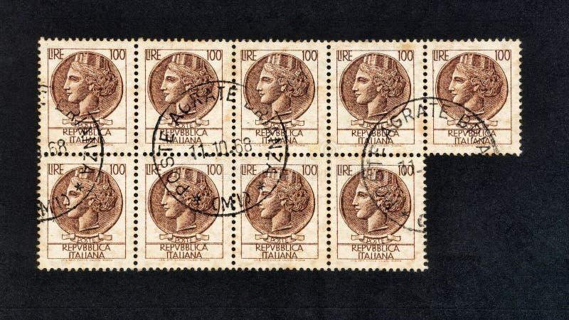 Italian stamps worth 100 lire Siracusana series used stock photo