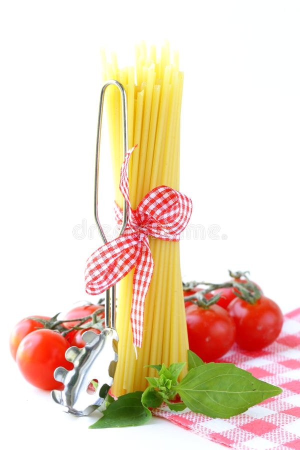 Italian still life - pasta, tomato and basil royalty free stock photos