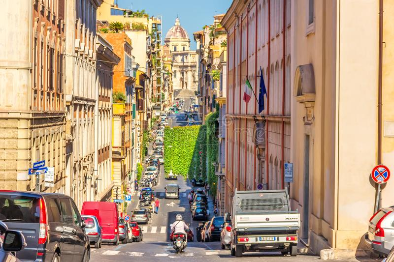 Italian Street with cars and tourists with a basilica on the hill stock photos