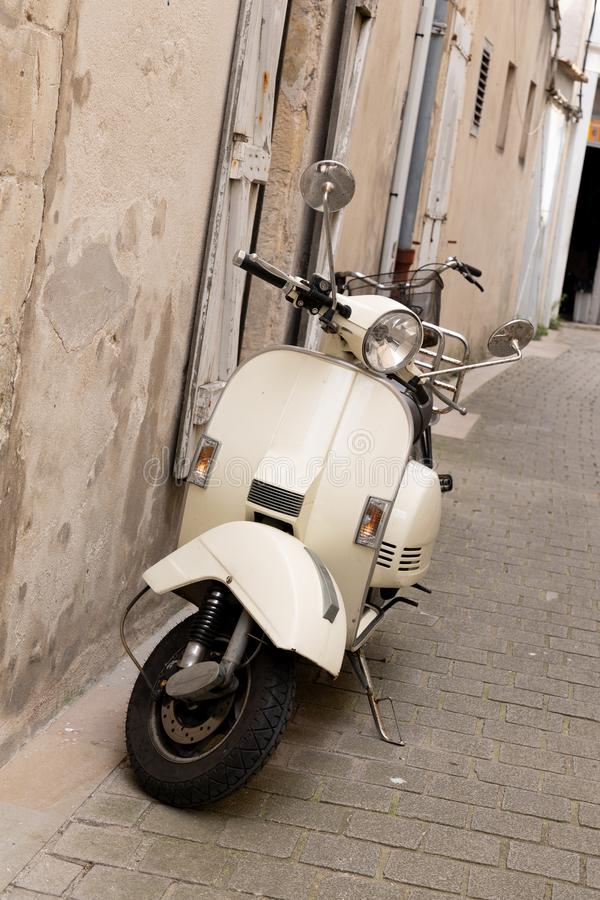 Italian streets city town and a popular single transport scooter parked by the wall in the empty street. An Italian streets city town and a popular single royalty free stock photos