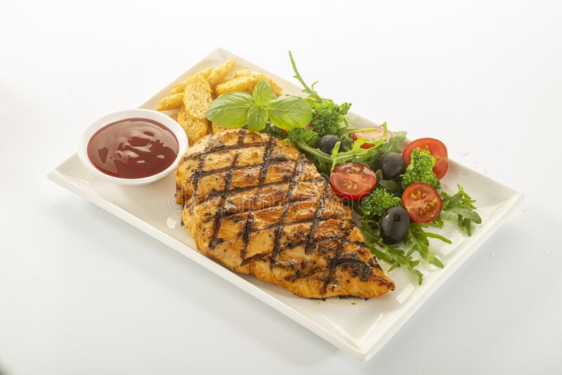 Italian style marinated chicken breast with fresh salads and tomato catchup on white rectangle royalty free stock photos