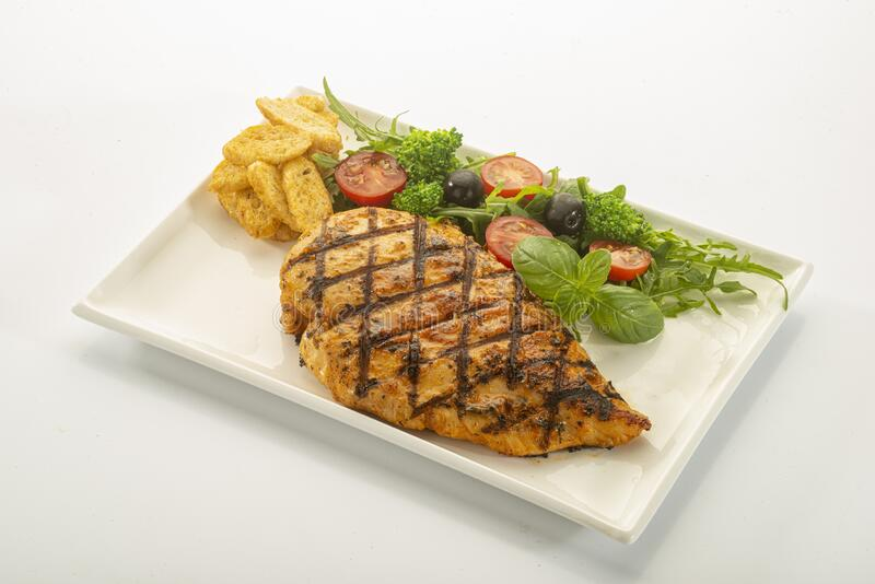 Italian style marinated chicken breast with fresh salads and tomato catchup on white rectangle stock photos