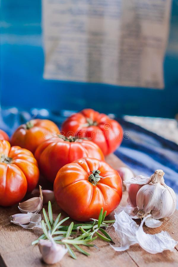 Some red tomatoes and garlic for pasta stock image