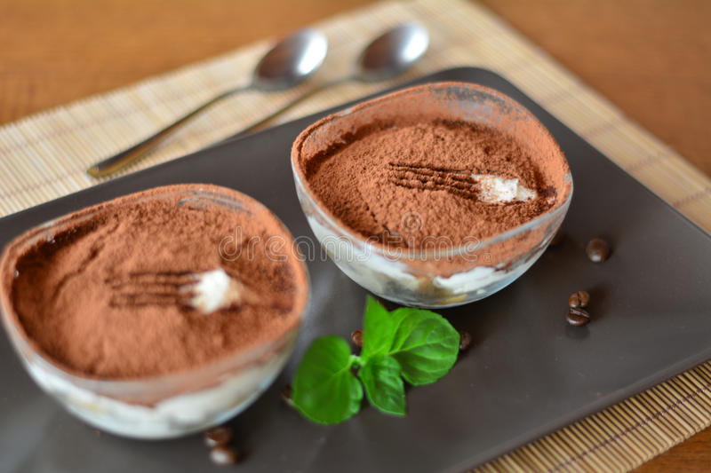 Italian tiramisu dessert on the wooden table stock photos