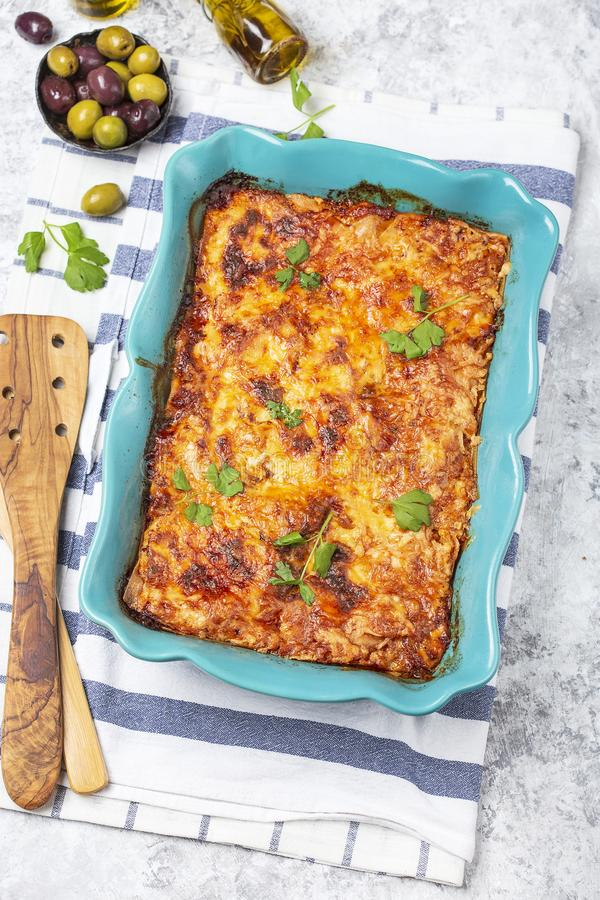 Italian traditional dish lasagna with tomato sause, beef stock photography
