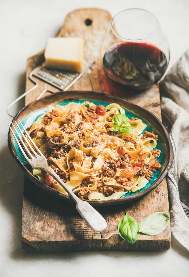 Italian traditional pasta dinner with tagliatelle bolognese and red wine royalty free stock images