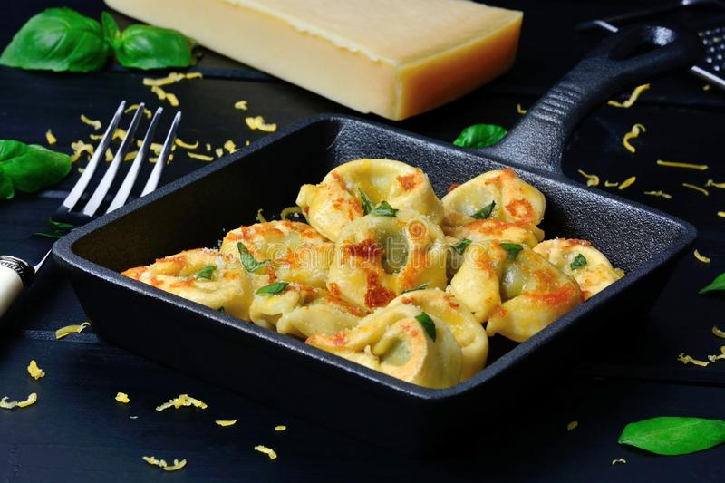 Italian traditional tortellini pasta in a pan on a wood table royalty free stock photos