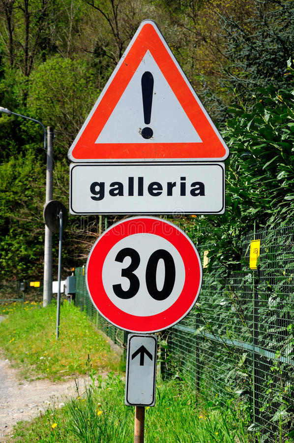 Italian traffic signs. Italian traffic signs warning about the tunnel and the speed limit royalty free stock image