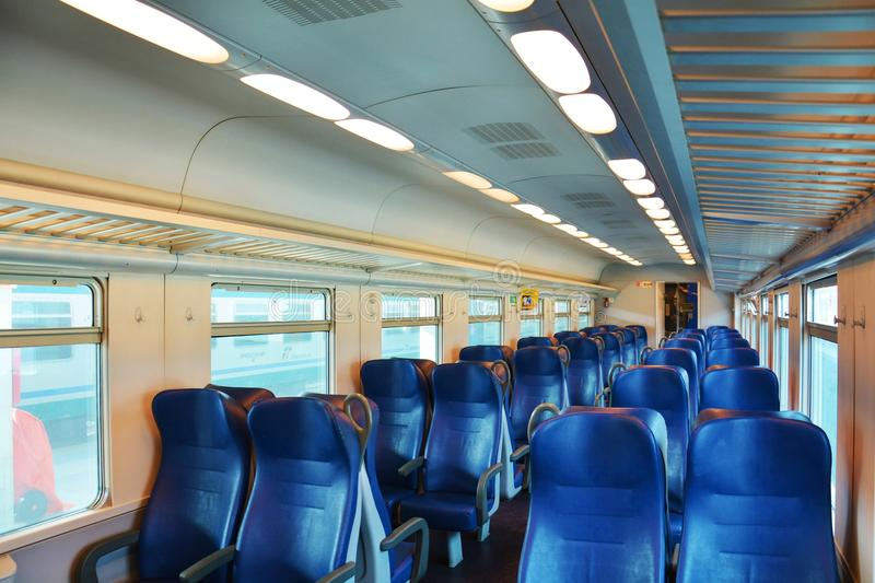 Italian train, empty chairs and windows royalty free stock image