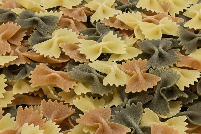 Italian tri-colored raw farfalle stock photo