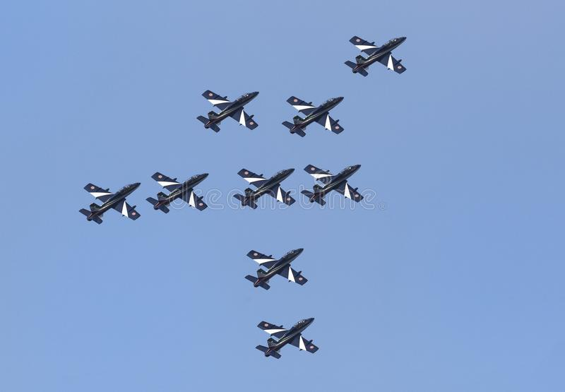 Planes jet of Italian tricolor arrows in acrobatic team during air show vector illustration