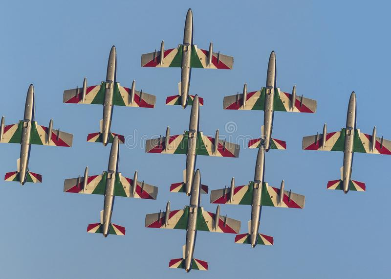 Planes jet of Italian tricolor arrows in a spectacular flight, during air show close up royalty free illustration