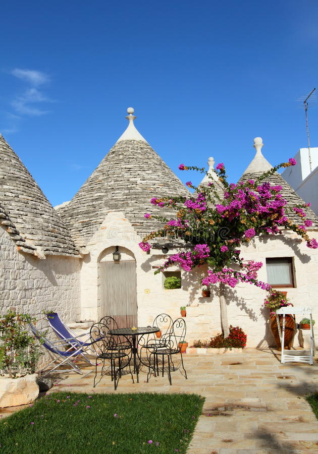Italian Trulli houses. Trulli houses with conical roofs in Alberobello, unesco world heritage, Italy royalty free stock photos
