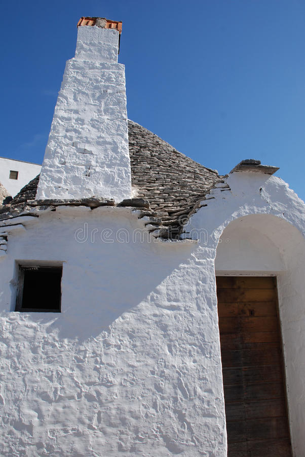 Italian Trullo. A traditional trullo house in Alberobello in Puglia, southern Italy. The trulli, which are protected under UNESCO World Heritage laws, are royalty free stock photo