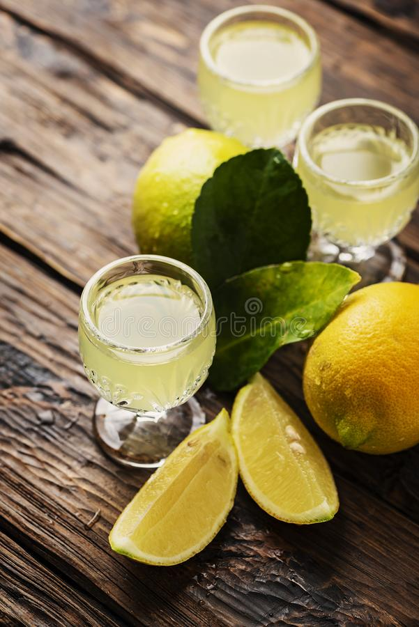Italian typical digestive limoncello with fresh lemons stock images