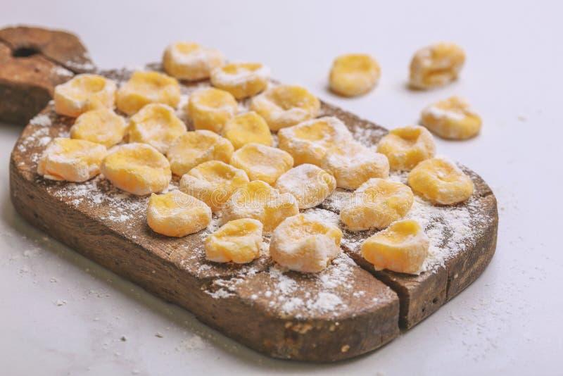Italian uncooked homemade potato gnocchi with flour. stock photo