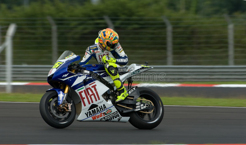 Italian Valentino Rossi Fiat Yamaha Team at 2007 P. Italian Valentino Rossi Fiat Yamaha Team looking back at other riders at 2007 Polini Malaysian Motorcycle stock photography