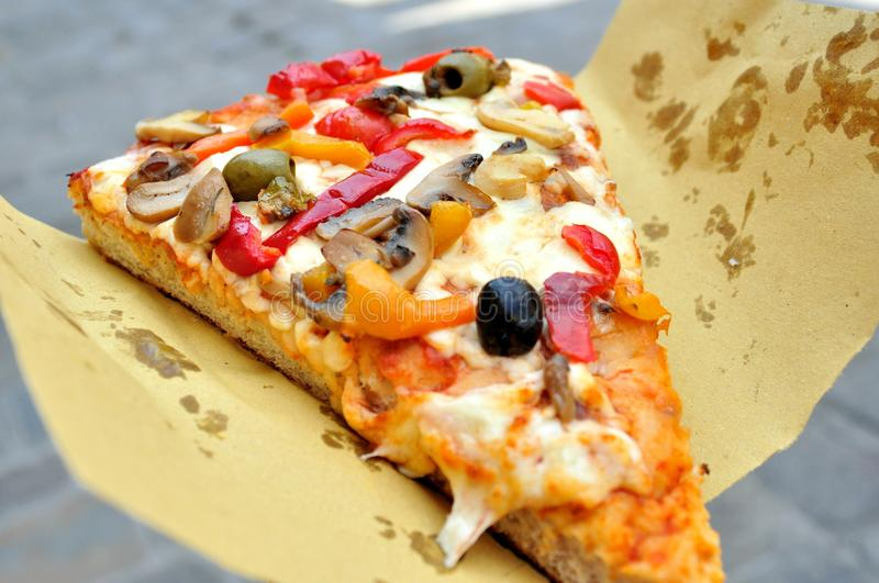 Italian vegetarian pizza on the streets of Italy royalty free stock photography