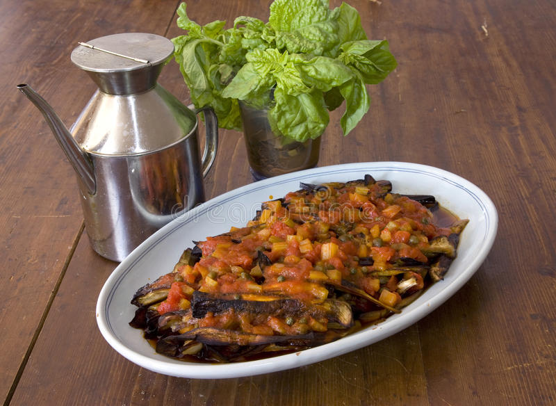 Italian vegetarian stew. Food background of eggplant and pepper stew from italian cuisine stock photos