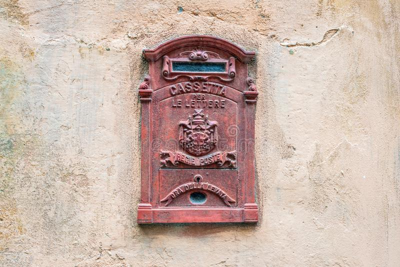 Italian vintage mailbox in a wall stock photography