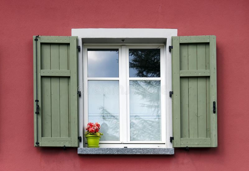 Italian window with green shutters royalty free stock photo