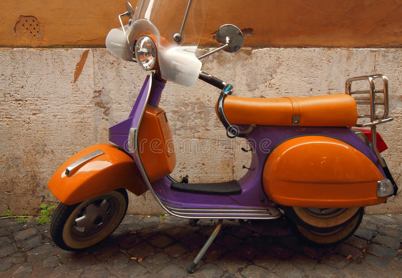Italian Yellow And Purple Scooter Royalty Free Stock Images