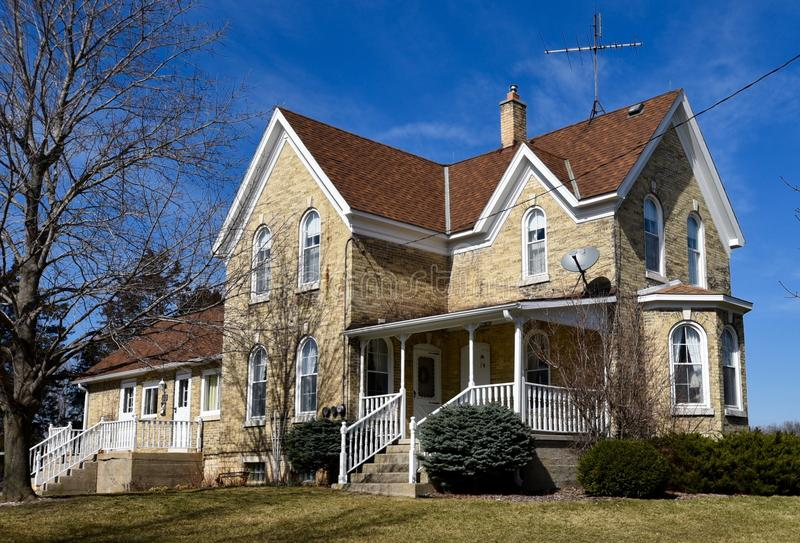 Italianate Farmhouse. This is a Spring picture of the farmhouse located on the Lurvey Farm located in Dousman, Wisconsin. This example of Italianate architecture royalty free stock image