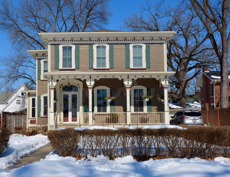 Italianate in Ottawa. This is a Winter picture of a house in Ottawa, Illinois. The house is an example of the Italianate style of architecture. This picture was stock photography