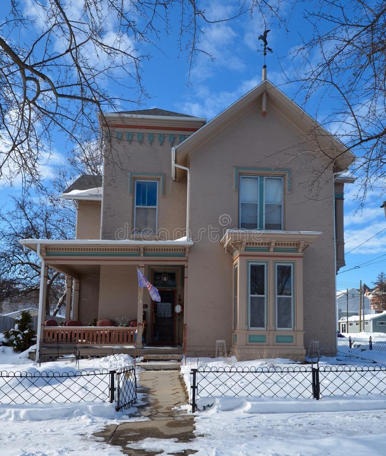 Italianate in Rochelle. This is a Winter picture of a house in Rochelle, Illinois. The house is an example of the Italianate style of architecture. This picture royalty free stock photos