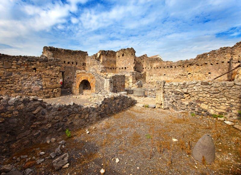 Italien. Fördärvar av Pompey.parts av stenhus arkivbilder