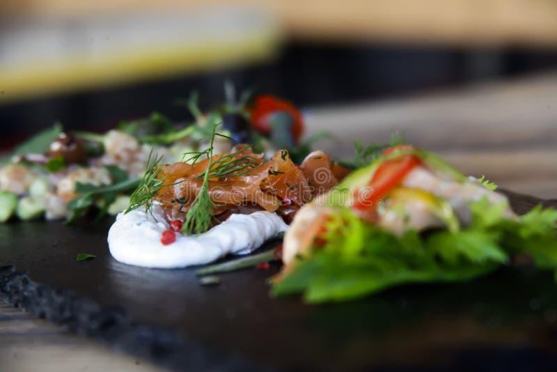Italienische Fische im Restaurant lizenzfreie stockbilder