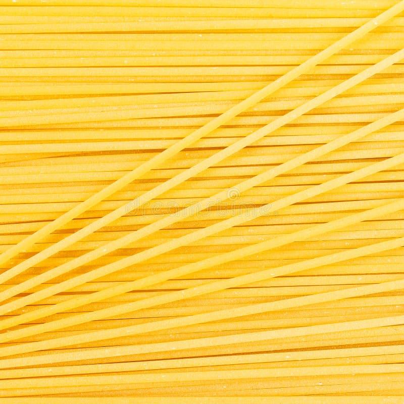 Italiensk bakgrund för mat för spagetti- eller nudelMacaronipasta texturerar royaltyfri fotografi