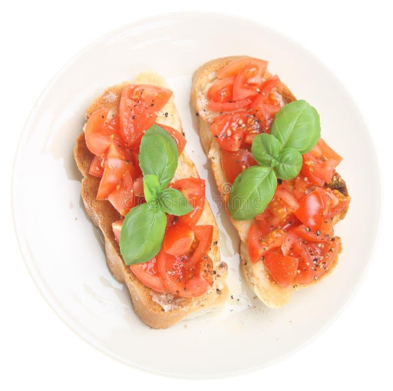 italienska rostat brödtomater för bruschetta royaltyfri fotografi