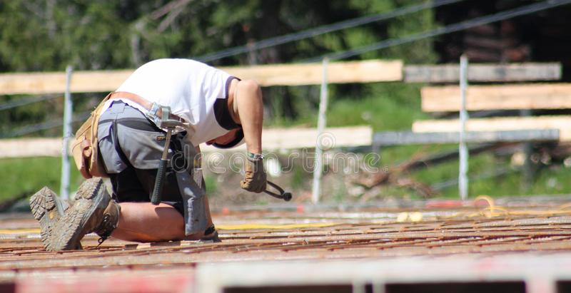 Man working in a construction site in Badia Bolzano Dolomites stock photos