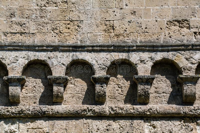 Italy. Bari. Castello Svevo di Bari, medieval fortress from the 13th century.  Detail of the line of hanging arches stock photography