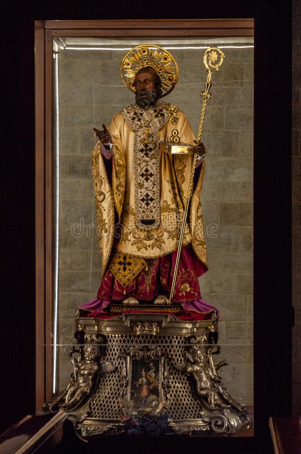 Italy. Bari. Popular devotion. The precious wooden simulacrum of St. Nicholas of Bari kept inside the basilica dedicated to him royalty free stock photos