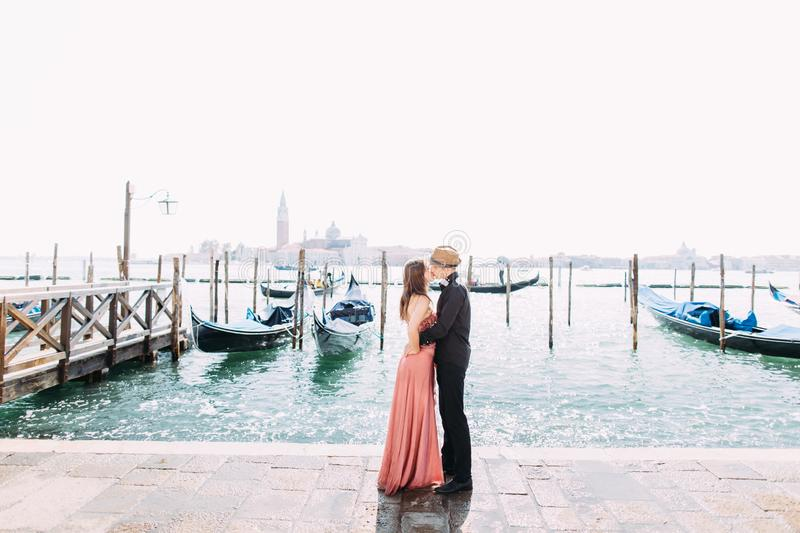 Italy beauty, pretty girl and boy with San Giorgio Maggiore and boat behind, Venezia, Venice stock images