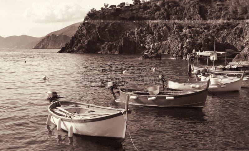 italy Cinque terre fartyg I tonad sepia retro stil arkivfoton